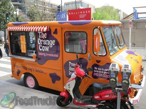orange cow truck